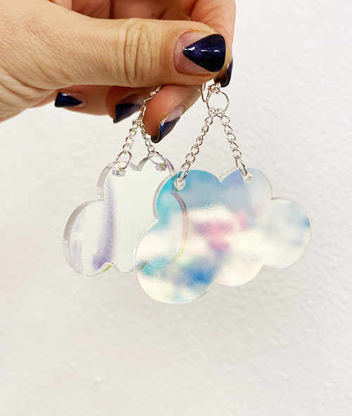 Cloud earrings in iridescent acrylic.