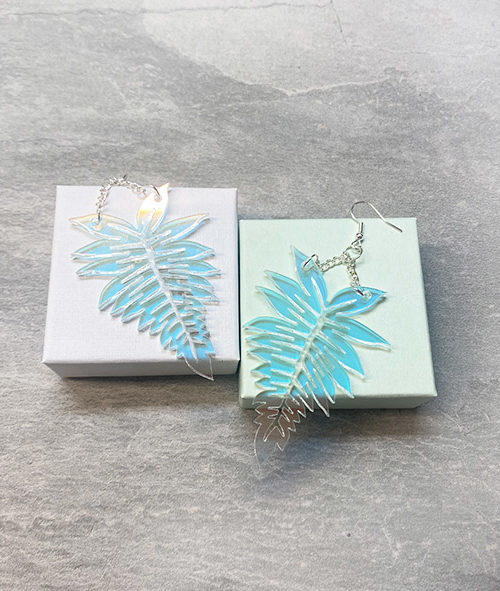 Fern shaped iridescent earrings.