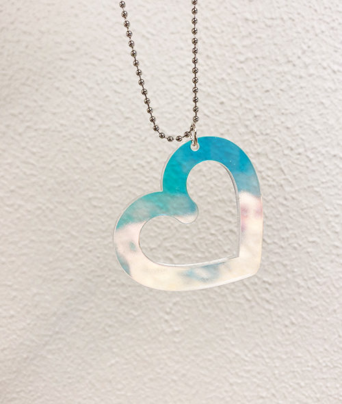 Heart shaped pendant in iridescent acrylic.