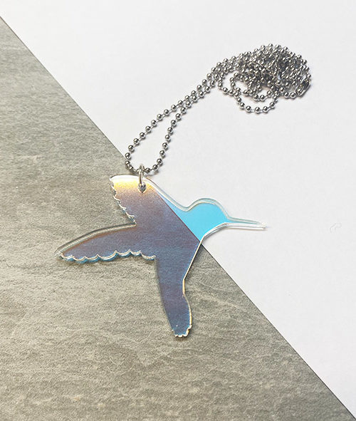 Humming bird shaped pendant in iridescent acrylic.